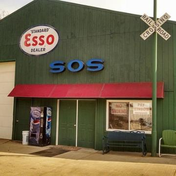 SOS Storefront With Railroad Crossing